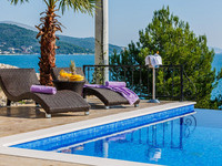 Seafront Villa with Infinity Pool, Sauna, and Fitness near Trogir